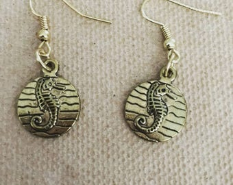 Two sets of seahorse earrings