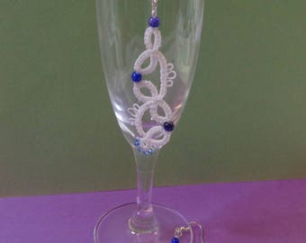 White tatting earrings and blue beads