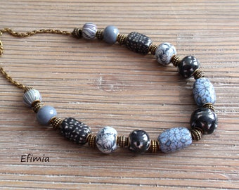 Beaded necklace winter tones in shades blue and black graphic