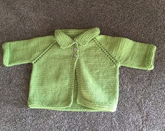 Hand knitted child's sweater, size 2