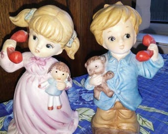 Adorable Retro girl and boy ceramic figurines!Sweet little duo, oh so Retro!Beautiful condition