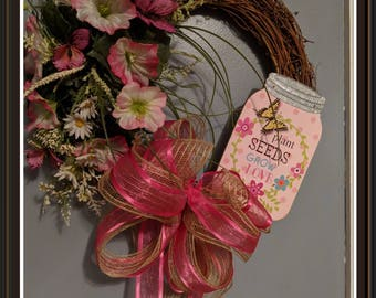 Spring grapevine wreath with sign