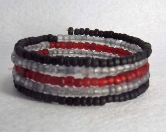 Bracelet of glass seed beads  on memory wire, 5 wrap,  Black, grey and red