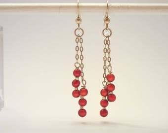 Silver drop earrings with red miracle beads