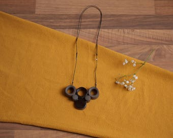Black contemporary ceramic necklace pendant handmade STUDIO ALBERT
