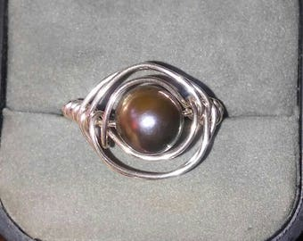 Size 9 Black Pearl ring that has a purpleish hue.  Very pretty with a nice Luster.