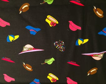 Fabric with Lots of Colored Hats on Black Background.