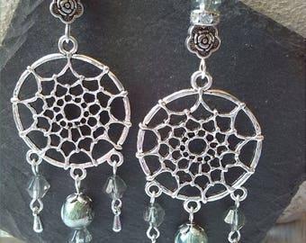 Dream catcher pendants on earrings
