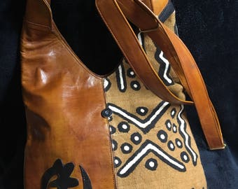 100%  genuine leather & Mud cloth shouder bag