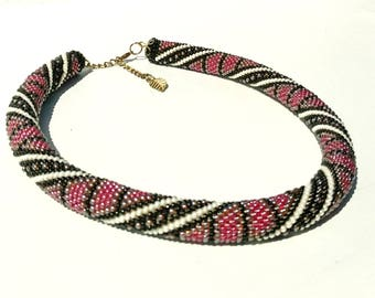 Necklace out off beads wich geometric pattern. Beaded Necklace. Crochet Necklace