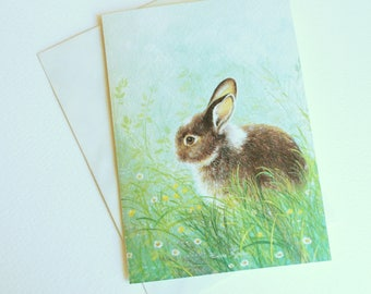Greeting card with image of a bunny in the garden