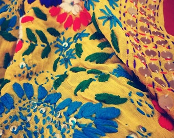 Multicolored shawl on yellow pure crepe fabric