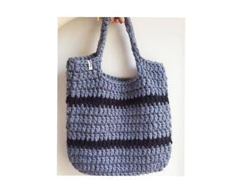 Grey crochet beach bag.