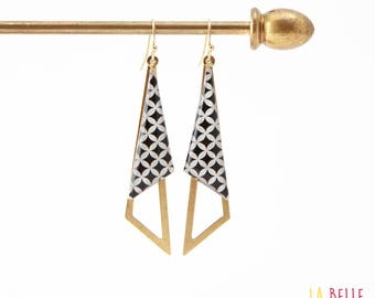 Earrings are made of resinees mosaic black and white graphic pattern