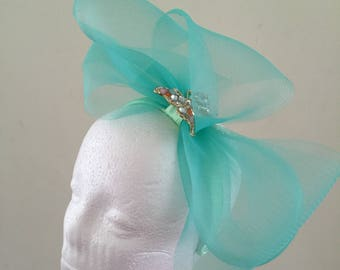 Teal crinoline bow fascinator with butterfly brooch