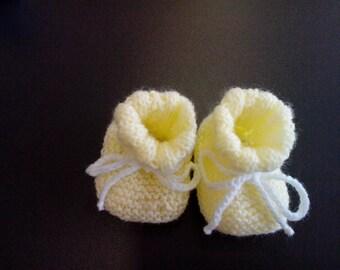 pale yellow newborn baby booties