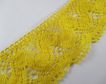 Lace cotton and viscose, yellow color, width 7.5 cm.
