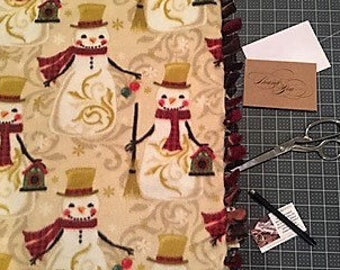 Getting Frosty! Holiday fleece blanket designed by JAX. This winter snowman theme throw makes gifting or decorating for the holidays a snap!