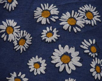 Bright daisies on bottom Blue Jeans