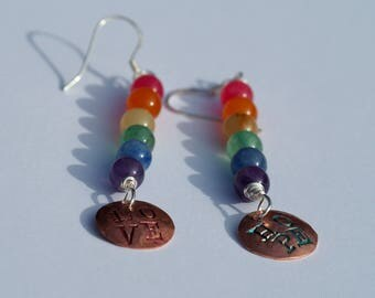 """Hand Stamped Rainbow Earrings. These say """"Hope"""" on one ear, """"Love"""" on the other ear. Copper and silver, handmade."""