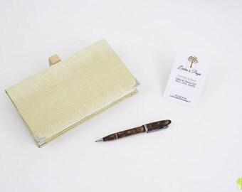 Protects checkbook / checkbook holder in ivory skivertex
