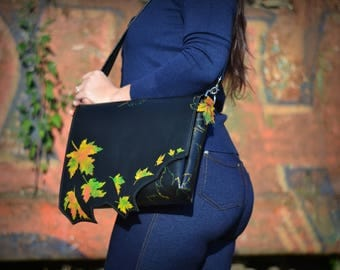 Black leather shoulder bag with painted autumn leaves. Strap detachable , can become a clutch / handbag. Fall fashion for ladies