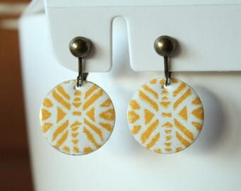 enamelled sequin tribal pattern yellow and ivory clip earrings