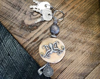 Keychain Maplewood Octopus, pipe and clock charm. Lucky for him