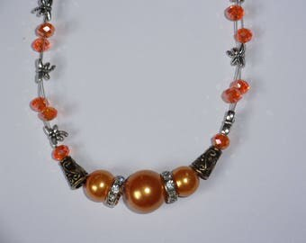 orange/peach tigertail necklace with dragonflie accent beads
