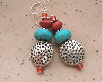 Turquoise, red seed and silver bead earrings with sterling silver hooks.