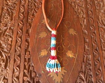 Vintage Native American hand beaded pendant on a buckskin strap