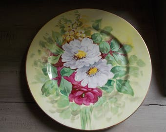 Authentic French Pretty Handpainted Floral Limoges Plate Charger from the pottery in Limoges, marked with the green star, gilt edge.