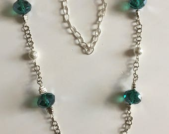Silver necklace with green glass beads