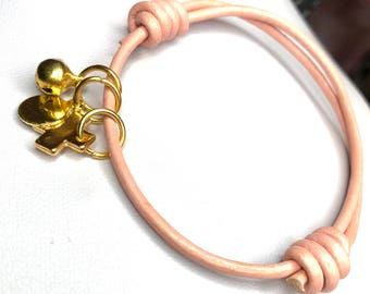 Adjustable pink leather and charms bracelet