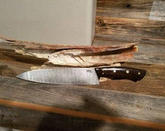 Chef knife.  Forged damascus and sanmai blade. Wenge wood  handle with mosaic pins. Vine file work on tang.  PRICE REDUCED