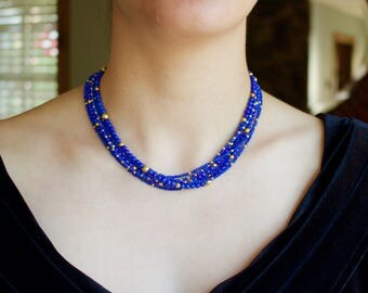 Six Strands of AAA Lapis Lazuli with 18k solid Gold beads and 14k solid gold clasp Necklace.