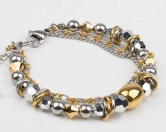 Swarovski, gold and silver stainless steel bracelet