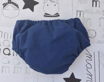 Cubrepañal Smooth blue shorts for baby.
