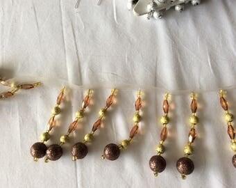 Bronze acrylic bead braid has sewing