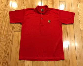 Ferarri automobile inspired polo shirt shortsleeve logo on front Red and yellow brand new size large unisex