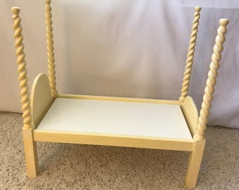 "Kids' doll bed designed for use with popular 18"" to 20"" dolls, spiral tapered four poster pine, milk paint finish, stores flat"