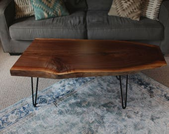 Mid century modern walnut coffee table with hairpin legs.
