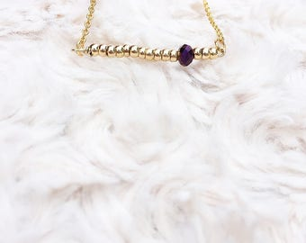 Gold and purple bead necklace