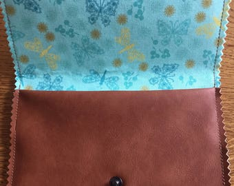Brown faux leather clutch