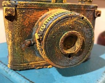 Brightly colored cement camera