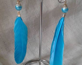 """pretty blue feather"" earrings"
