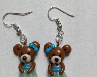 Earrings: small were Brown dressed in a blue dress ice