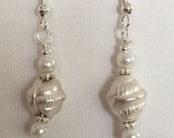 White pearl dangle earrings. White drop earrings. Pearl and silver embellishment on silver wire.