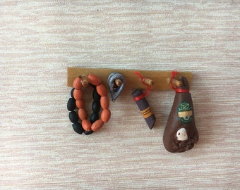 Miniature kitchen rack with sausage and ham