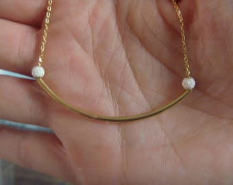 tube necklace gold and pearls